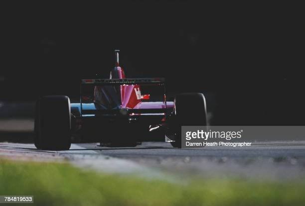 Eddie Irvine of Great Britain drives the Scuderia FerrariFerrari F310 Ferrari V10 during the Formula One Italian Grand Prix on 8 September 1996 at...