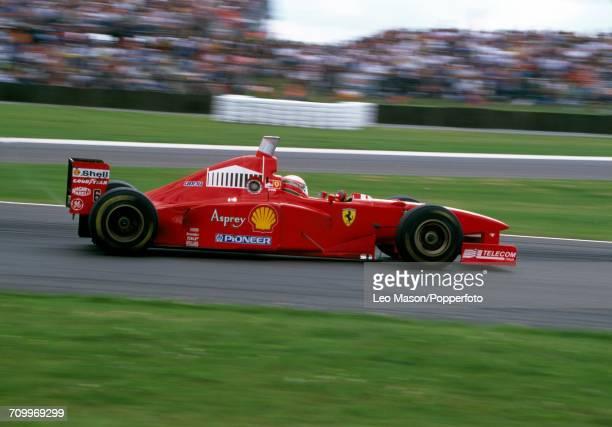 Eddie Irvine of Great Britain, driving a Ferrari F310B with a Ferrari 046/2 V10 engine for Scuderia Ferrari Marlboro, in action during the British...