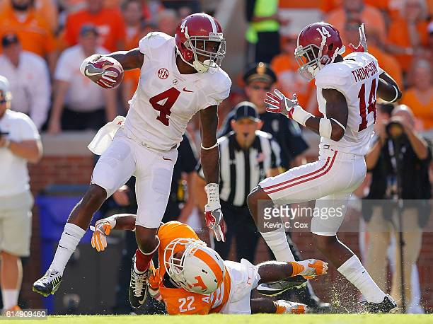 Eddie Jackson of the Alabama Crimson Tide breaks a tackle by Micah Abernathy of the Tennessee Volunteers on a punt return at Neyland Stadium on...