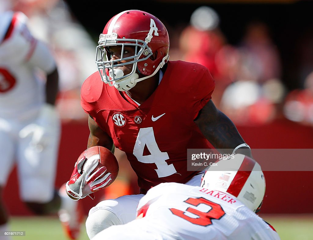 Eddie Jackson #4 of the Alabama Crimson Tide returns an interception for a touchdown as he runs past Quinton Baker #3 of the Western Kentucky Hilltoppers at Bryant-Denny Stadium on September 10, 2016 in Tuscaloosa, Alabama.