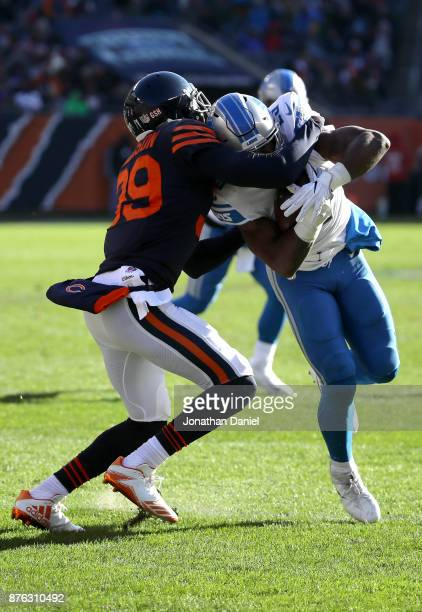 Eddie Jackson of the Chicago Bears attempts to tackle Theo Riddick of the Detroit Lions in the second quarter at Soldier Field on November 19 2017 in...