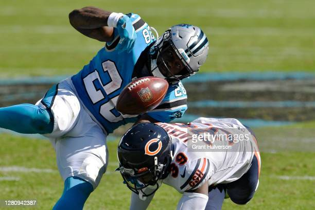 Eddie Jackson of the Chicago Bears forces a fumble against Mike Davis of the Carolina Panthers in the third quarter at Bank of America Stadium on...