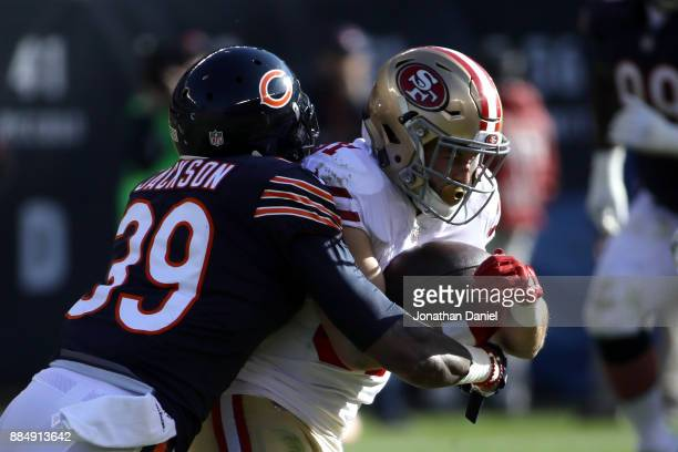 Eddie Jackson of the Chicago Bears hits Trent Taylor of the San Francisco 49ers in the second quarter at Soldier Field on December 3 2017 in Chicago...
