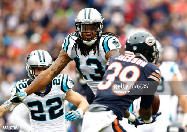Eddie Jackson of the Chicago Bears intercepts the pass intended for Kelvin Benjamin of the Carolina Panthers in the second quarter at Soldier Field...