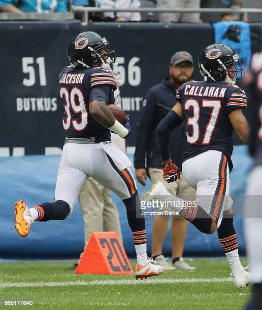 Eddie Jackson of the Chicago Bears returns an interception for a touchdown as teammte Bryce Callahan runs with him against the Carolina Panthers at...