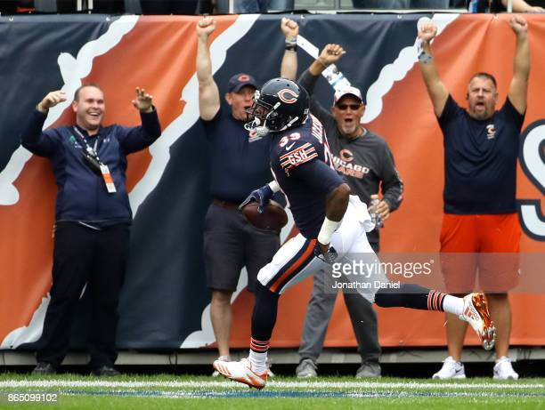 Eddie Jackson of the Chicago Bears scores a touchdown on an interception against the Carolina Panthers in the second quarter at Soldier Field on...