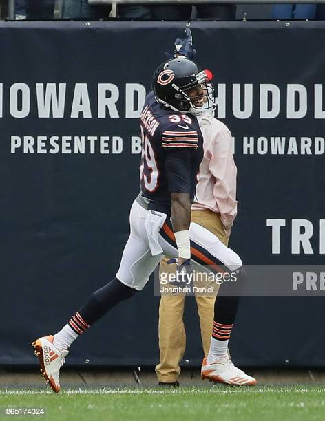 Eddie Jackson of the Chicago Bears smiles after returning an interception for a touchdown early against the Carolina Panthers at Soldier Field on...