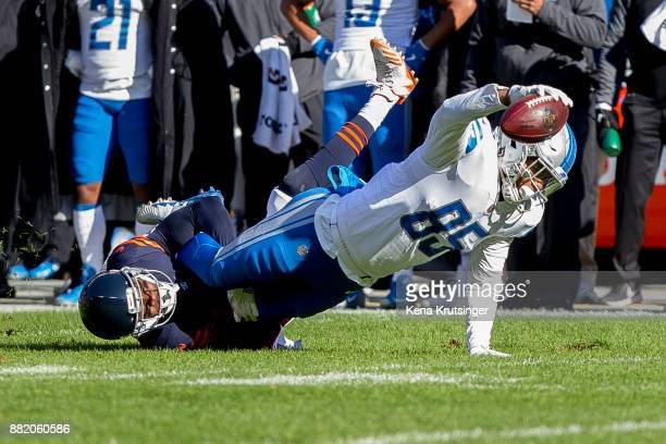 Eddie Jackson of the Chicago Bears tackles Eric Ebron of the Detroit Lions in the first quarter at Soldier Field on November 19 2017 in Chicago...