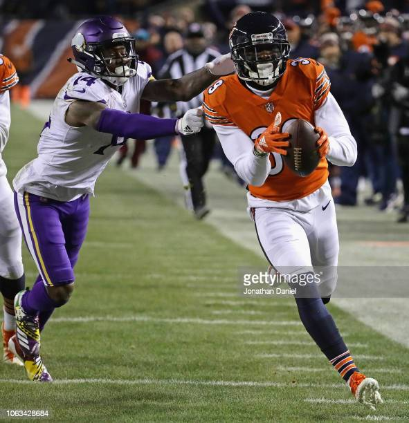 Eddie Jackson of the Chicago Bearsnreturns an interception for a touchdown past Stefon Diggs of the Minnesota Vikings at Soldier Field on November 18...
