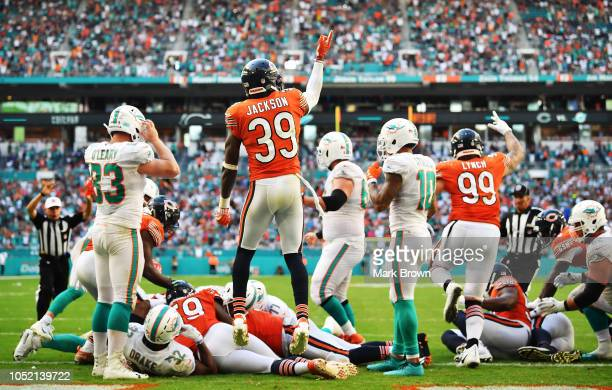 Eddie Jackson reacts after Eddie Goldman of the Chicago Bears recovered a fumble by Kenyan Drake of the Miami Dolphins in overtime during the game at...