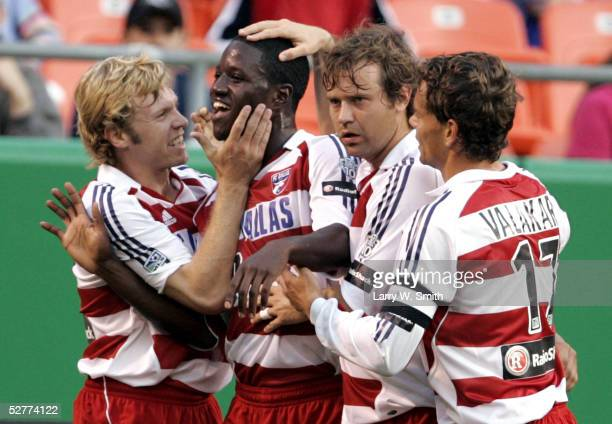 Eddie Johnson of FC Dallas celebrates with teammates after assisting on a goal in the first half of the game against the Kansas City Wizards on May...