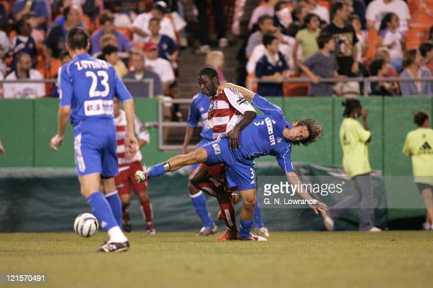 Eddie Johnson of FC Dallas holds back Nick Garcia of the Kansas City Wizards during an MLS game on May 7 2005 at Arrowhead Stadium in Kansas City Mo...