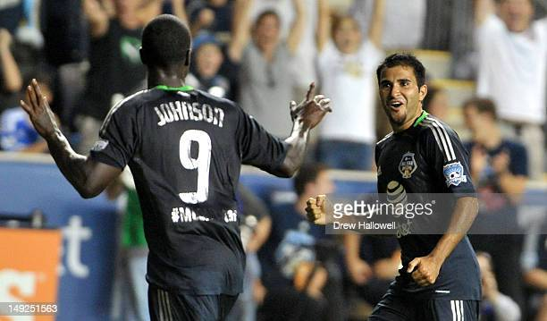 Eddie Johnson of MLS All-Stars celebrates with Steven Beitashour after Johnson scores a go-ahead goal late in the second half during the 2012 AT&T...