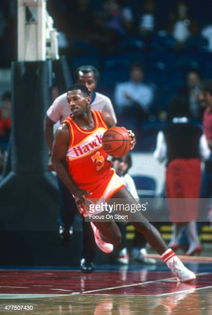 Eddie Johnson of the Atlanta Hawks dribbles the ball against the Washington Bullets during an NBA basketball game circa 1984 at the Capital Centre in...