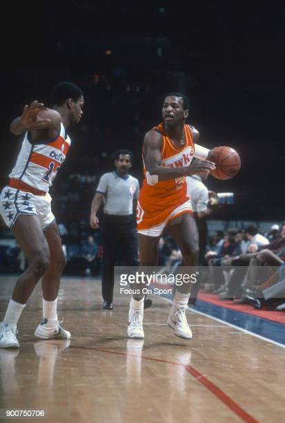 Eddie Johnson of the Atlanta Hawks dribbles the ball against the Washington Bullets during an NBA basketball game circa 1982 at the Capital Centre in...
