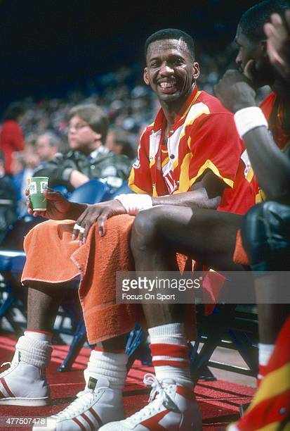 Eddie Johnson of the Atlanta Hawks looks on from the bench smiling against the Washington Bullets during an NBA basketball game circa 1985 at the...