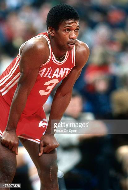 Eddie Johnson of the Atlanta Hawks looks on while there's a break in the action against the Washington Bullets during an NBA basketball game circa...