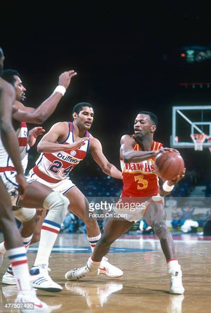 Eddie Johnson of the Atlanta Hawks looks to make a pass against the Washington Bullets during an NBA basketball game circa 1985 at the Capital Centre...