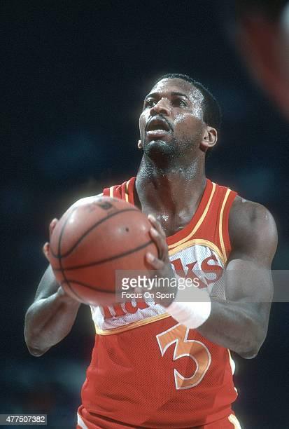Eddie Johnson of the Atlanta Hawks sets to shoot a free throw against the Washington Bullets during an NBA basketball game circa 1982 at the Capital...