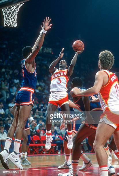 Eddie Johnson of the Atlanta Hawks shoots over Ron Cavenall of the New York Knicks during an NBA basketball game circa 1984 at the Omni Coliseum in...