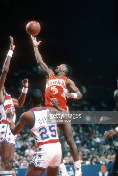 Eddie Johnson of the Atlanta Hawks shoots the ball against the Washington Bullets during an NBA basketball game circa 1982 at the Capital Centre in...