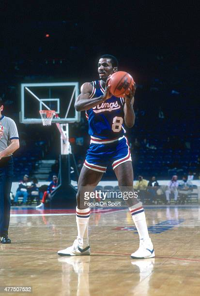Eddie Johnson of the Kansas City Kings looks to make a pass against the Washington Bullets during an NBA basketball game circa 1982 at the Capital...