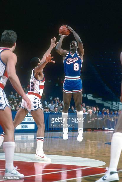 Eddie Johnson of the Kansas City Kings shoots over Greg Ballard of the Washington Bullets during an NBA basketball game circa 1983 at the Capital...