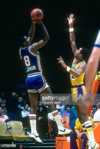 Eddie Johnson of the Kansas City Kings shoots over Jamaal Wilkes of the Los Angeles Lakers during an NBA basketball game circa 1983 at The Forum in...