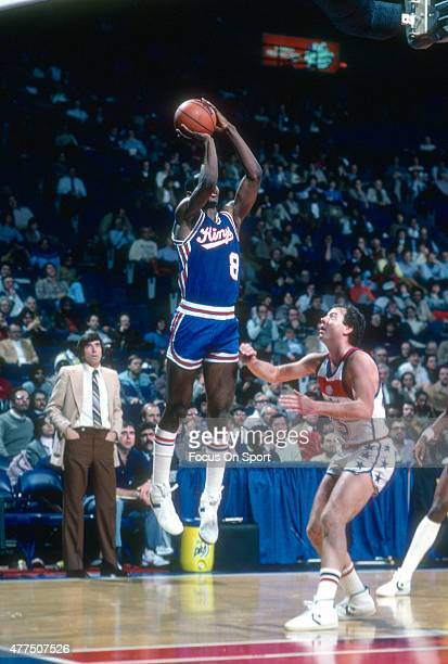 Eddie Johnson of the Kansas City Kings shoots over Kevin Grevey of the Washington Bullets during an NBA basketball game circa 1982 at the Capital...