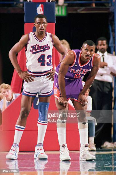 Eddie Johnson of the Phoenix Suns rests against Derek Smith of the Sacramento Kings circa 1988 at Arco Arena in Sacramento California NOTE TO USER...