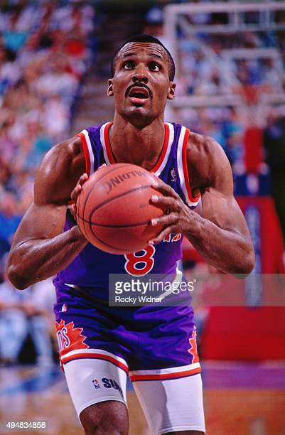 Eddie Johnson of the Phoenix Suns shoots a foul shot against the Sacramento Kings circa 1990 at Arco Arena in Sacramento California NOTE TO USER User...