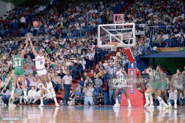 Eddie Johnson of the Sacramento Kings blocks a shot attempt against the Dallas Mavericks on March 9 1986 at Arco Arena in Sacramento California NOTE...