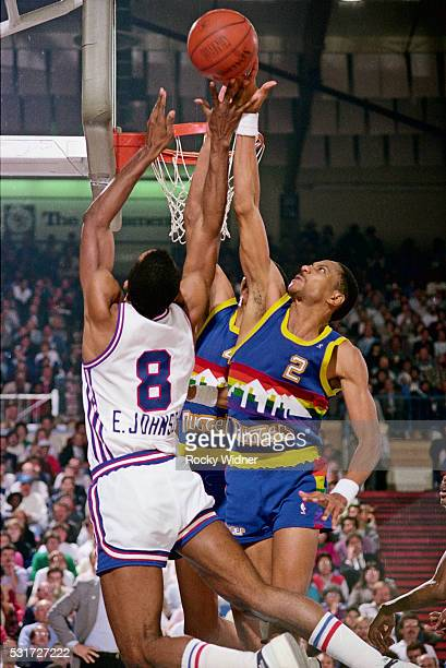 Eddie Johnson of the Sacramento Kings drives to the basket while guarded by Alec English of the Denver Nuggets on December 16 1986 at Arco Arena in...