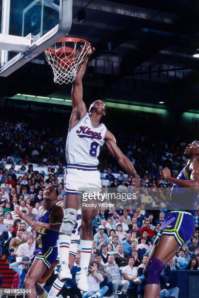 Eddie Johnson of the Sacramento Kings dunks against the Utah Jazz during a game played circa 1987 at Arco Arena in Sacramento California NOTE TO USER...