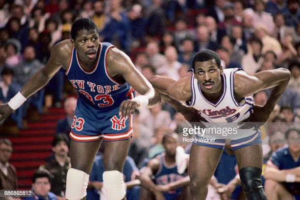 Eddie Johnson of the Sacramento Kings looks on against Patrick Ewing of the New York Knicks on February 3 1986 at Arco Arena in Sacramento California...