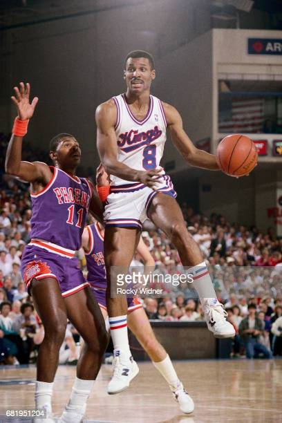 Eddie Johnson of the Sacramento Kings passes the ball against the Phoenix Suns during a game played circa 1987 at Arco Arena in Sacramento California...