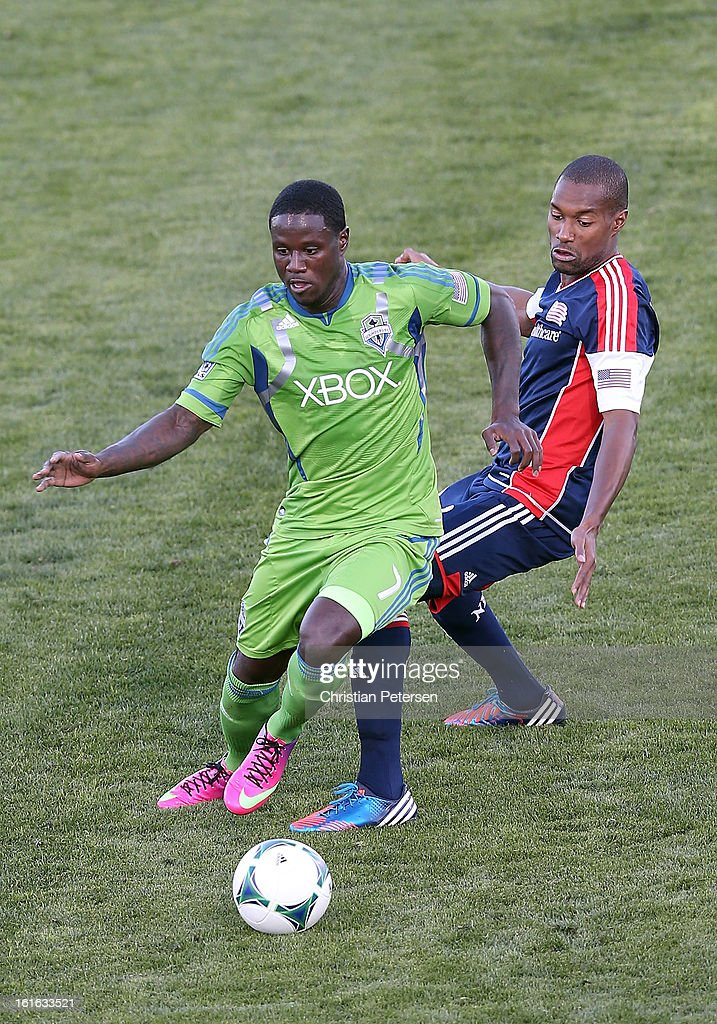 Eddie Johnson #7 of the Seattle Sounders controls the ball under pressure from Jose Goncalves #23 of the New England Revolution during the first half of the FC Tucson Desert Diamond Cup at Kino Sports Complex on February 13, 2013 in Tucson, Arizona.