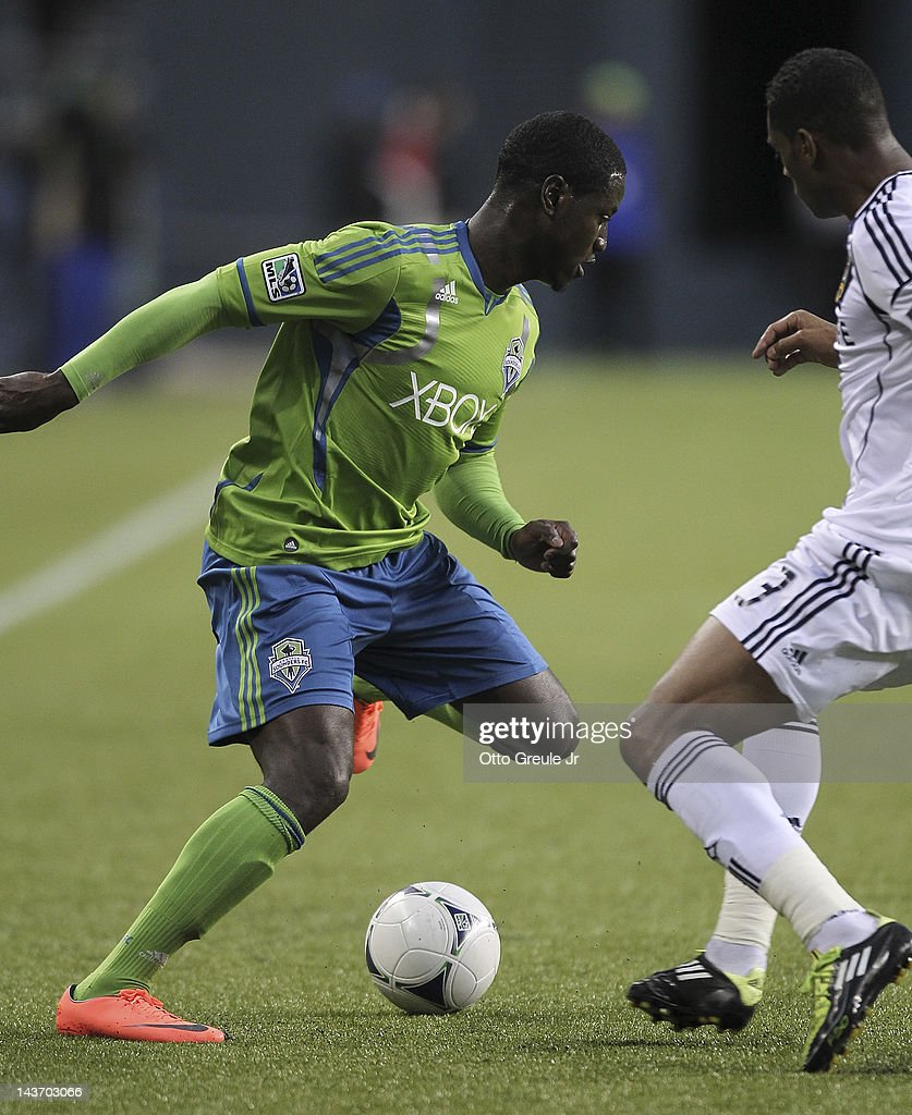 Eddie Johnson #7 of the Seattle Sounders dribbles against David Junior Lopes #3 of the Los Angeles Galaxy at CenturyLink Field on May 2, 2012 in Seattle, Washington. The Sounders defeated the Galaxy 2-0.