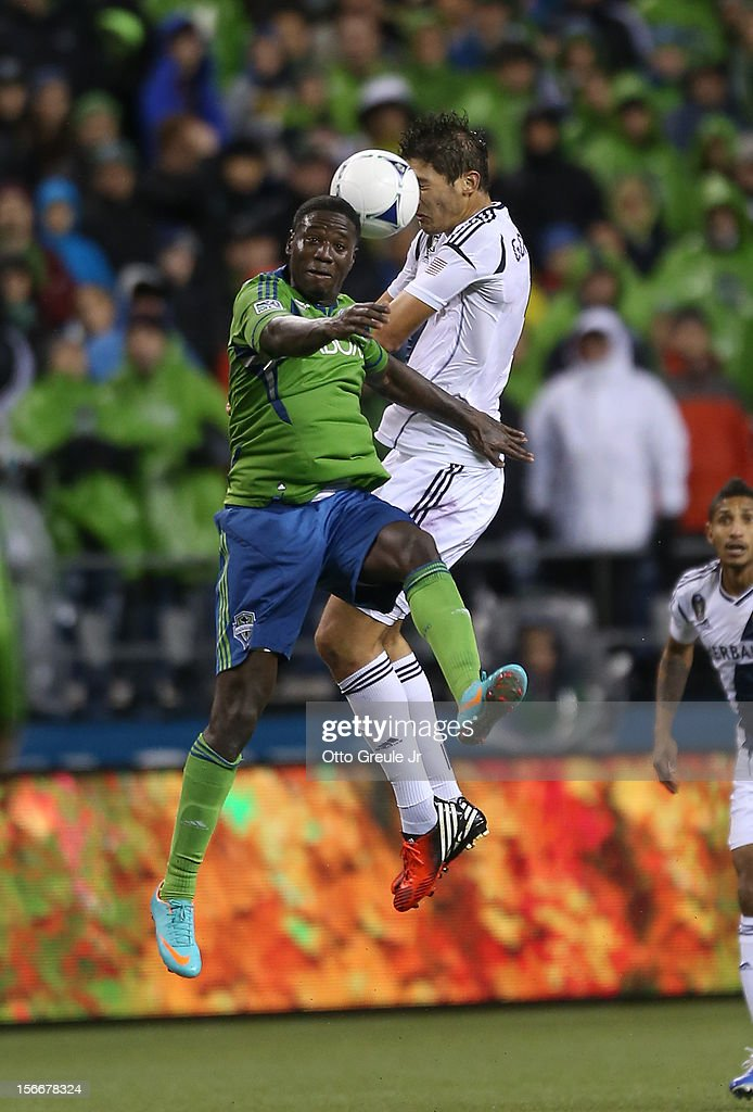 Eddie Johnson #7 of the Seattle Sounders FC battles Omar Gonzalez #4 of the Los Angeles Galaxy during Leg 2 of the Western Conference Championship at CenturyLink Field on November 18, 2012 in Seattle, Washington. The Galaxy defeated the Sounders 2-1, winning the aggregate playoff 4-2.