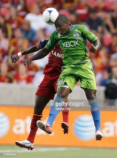 Eddie Johnson of the Seattle Sounders heads the ball over Kenny Mansally of Real Salt Lake during the first half of an MLS soccer game July 4 2012 at...