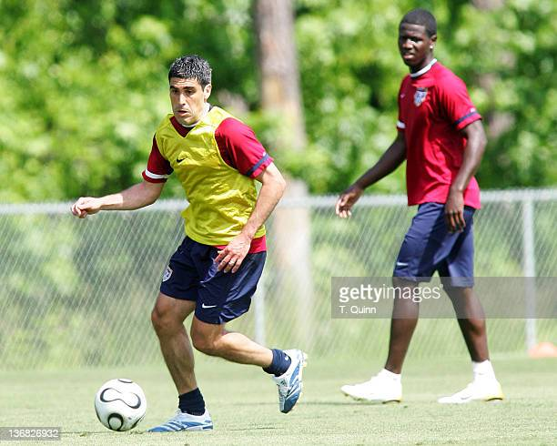 Eddie Johnson watches Claudio Reyna push the ball forward In the final training session at the camp at SAS Park in Cary North Carolina on May 21 2006