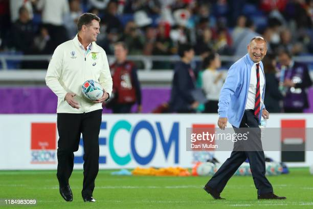 Eddie Jones Head Coach of England and Rassie Erasmus Head Coach of South Africa react after shaking hands on the pitch prior to the Rugby World Cup...