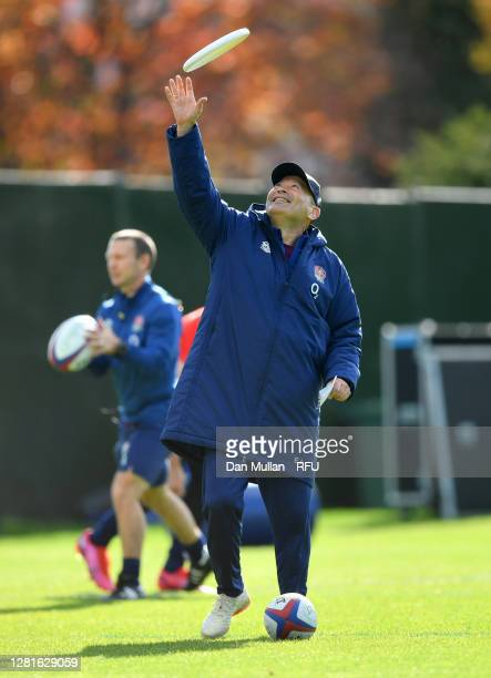 Eddie Jones Head coach of England catches a frisbee during a England training session at The Lensbury on October 22 2020 in Teddington England