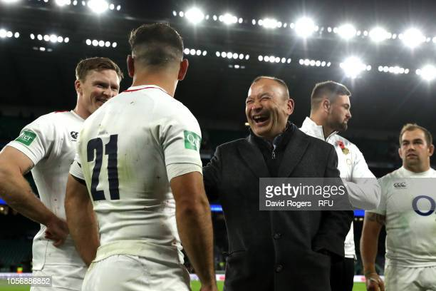 Eddie Jones, Head Coach of England celebrates victory with his team following the Quilter International match between England and South Africa at...