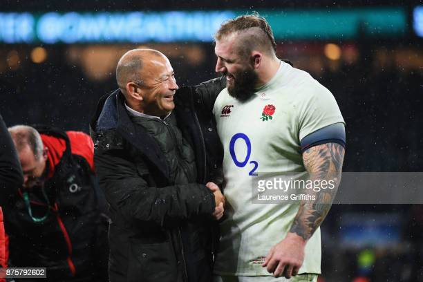 Eddie Jones head coach of England congratulates Joe Marler of England after the Old Mutual Wealth Series match between England and Australia at...