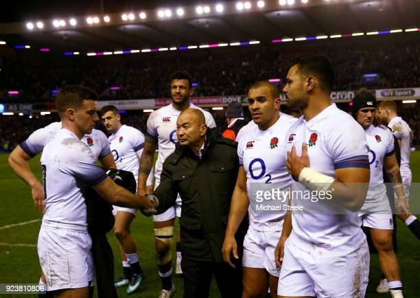 Eddie Jones Head Coach of England consoles George Ford and the team after defeat in the NatWest Six Nations match between Scotland and England at...