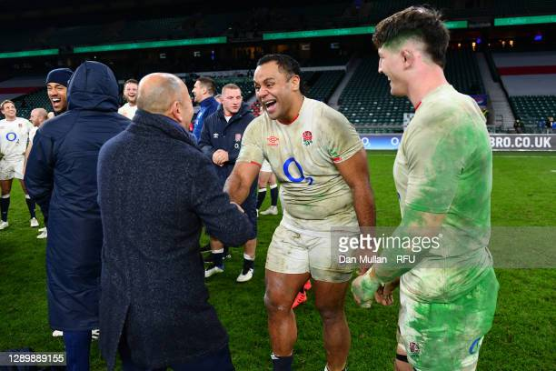 Eddie Jones, Head Coach of England embraces Billy Vunipola of England following their side's victory during the Autumn Nations Cup Final & Quilter...