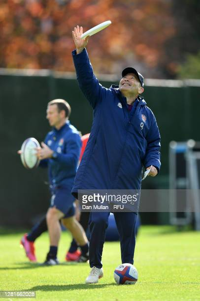 Eddie Jones Head Coach of England gathers a frisbee during a training session at The Lensbury on October 22 2020 in Teddington England