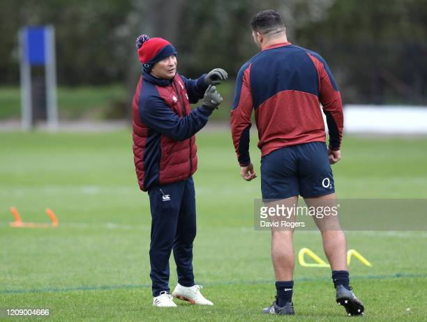 Eddie Jones Head coach of England gives instructions to Ellis Genge at St Edward's School on February 27 2020 in Oxford England
