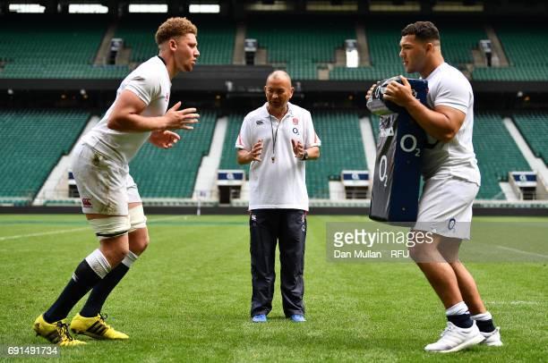 Eddie Jones Head Coach of England instructs Nick Isiekwe of England with Ellis Genge of England during a training session at Twickenham Stadium on...